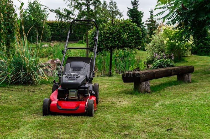 A Grassmower in a garden.  stock image