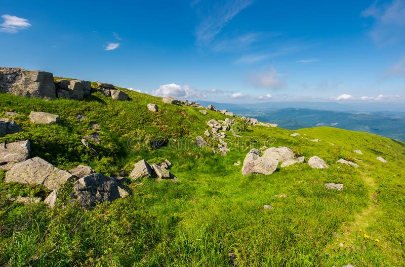 Beautiful summer scenery in wonderful weather. Grassy meadow on hillside. huge rocky formation. beautiful summer scenery in wonderful weather royalty free stock photography