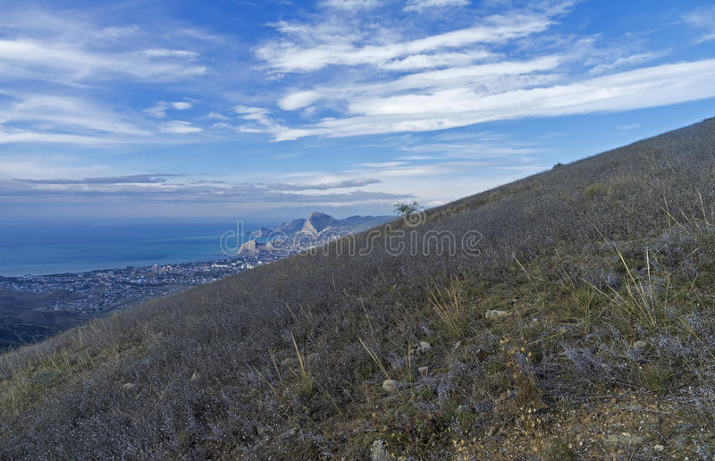 Grassy slope near the top of a mountain. Crimea, September. Grassy slope near the top of the Ai-Giorg mountain. Areal view on Sudak Bay. Crimea, September stock photography
