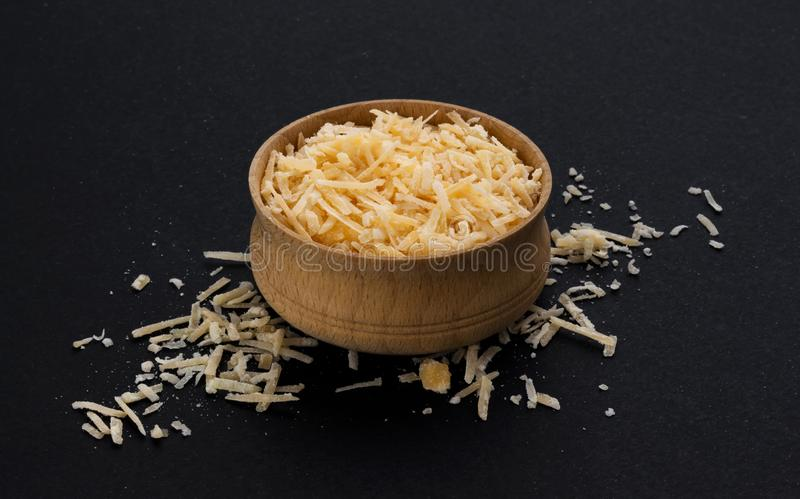 Grated parmesan cheese on black background stock image