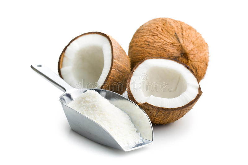 Grated, whole and halved coconut. On white background stock photos