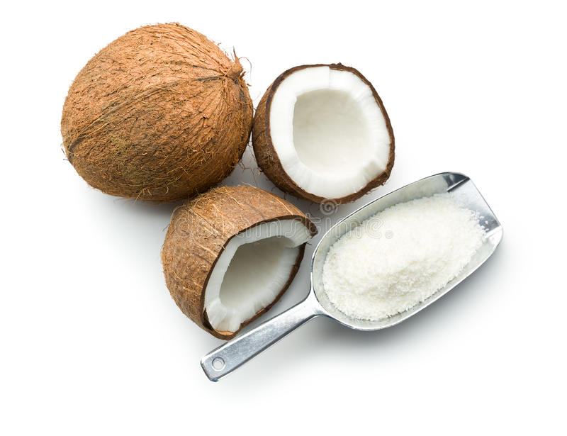 Grated, whole and halved coconut. On white background royalty free stock image