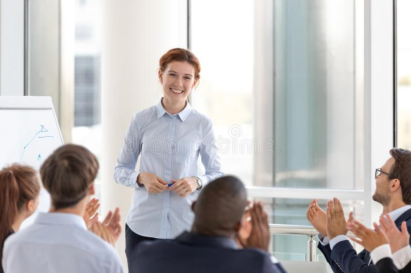 Grateful business audience applauding speaker coach thanking for conference stock photography