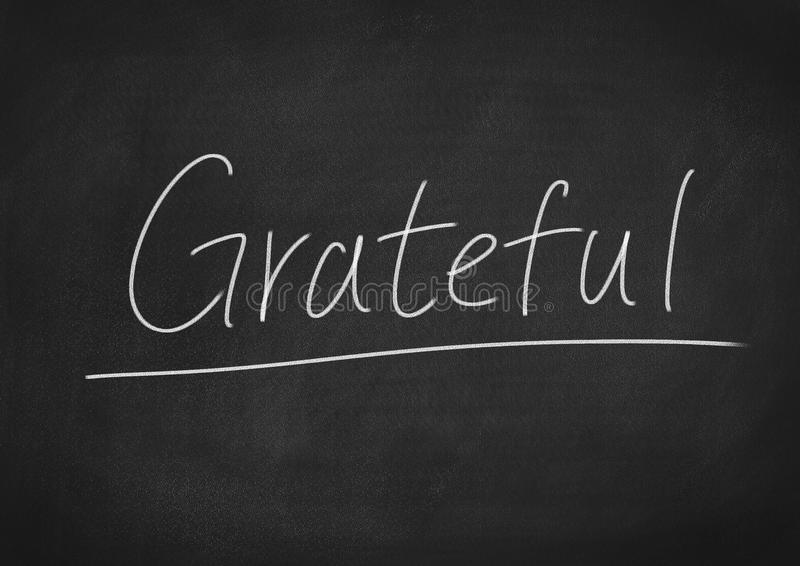 Grateful. Concept word on blackboard background royalty free stock image