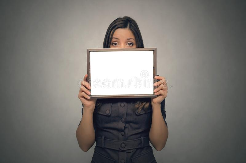 Blank photo frame border in woman hands. Diploma. Certificate. royalty free stock photography