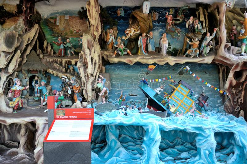 The grateful tortoise tableaux at Haw Par Villa in Singapore royalty free stock images