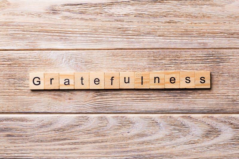 Gratefulness słowo pisać na drewnianym bloku gratefulness tekst na drewnianym stole dla twój desing, pojęcie obrazy stock