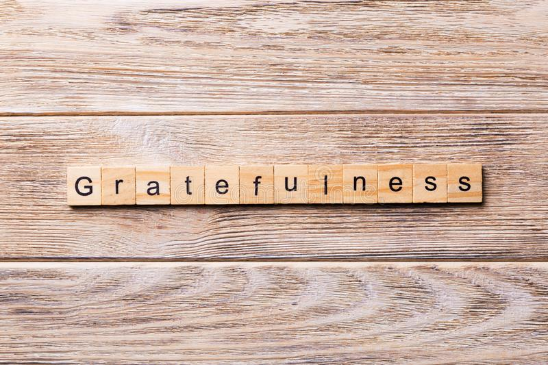 Gratefulness word written on wood block. gratefulness text on wooden table for your desing, concept.  stock images