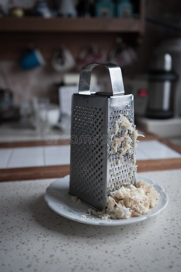 Grater on the kitchen royalty free stock photography