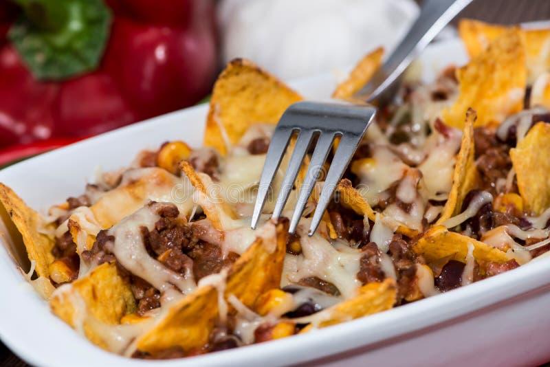 Gratin de Nacho avec chili con carne image stock