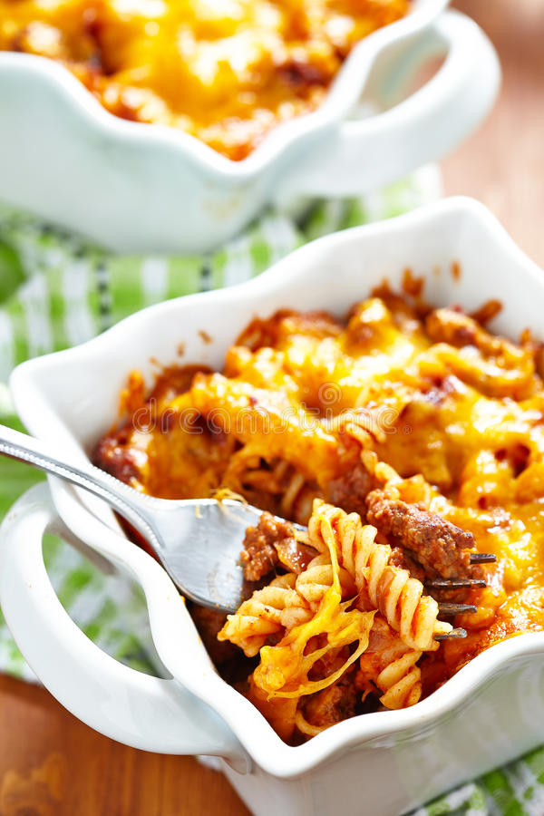 Gratin with macaroni, meat and cheese. Gratin with macaroni, meat, cheese and tomato sauce royalty free stock photography