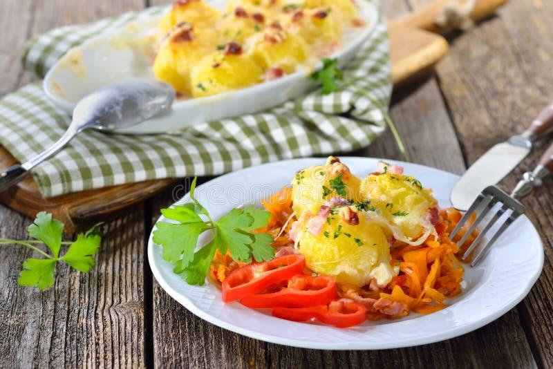 Gratinated potato dumplings stock photos