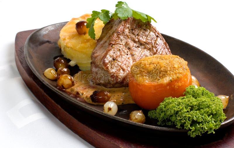 gratine w för nötköttfilévitlök royaltyfri fotografi