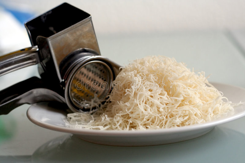 Download Grating Cheese Royalty Free Stock Photography - Image: 556967
