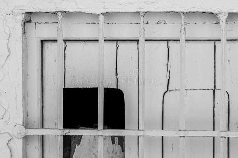 Grating of old window in black and white stock photo