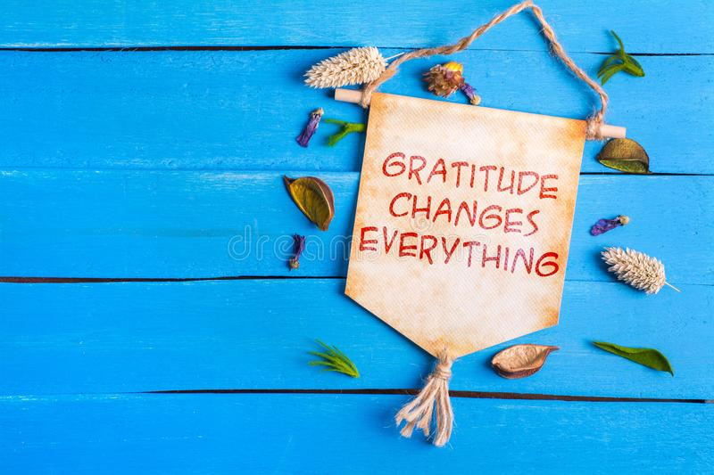 Gratitude changes everything text on Paper Scroll stock image
