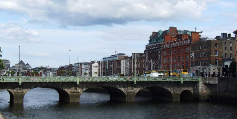 Grattan bridge over the River Liffey in Dublin. Traffic jam on the embankment near Grattan bridge over the River Liffey, Dublin, Ireland royalty free stock images