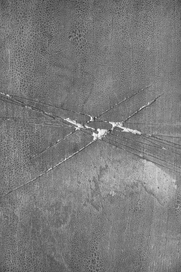 Grau knackte Hintergrund mit Kratzern Grunge Hintergründe lizenzfreie stockfotografie