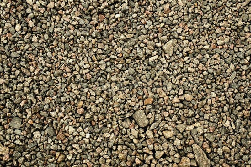 Grau zerquetschte Steingranitlandschaft und -bau stockfotos