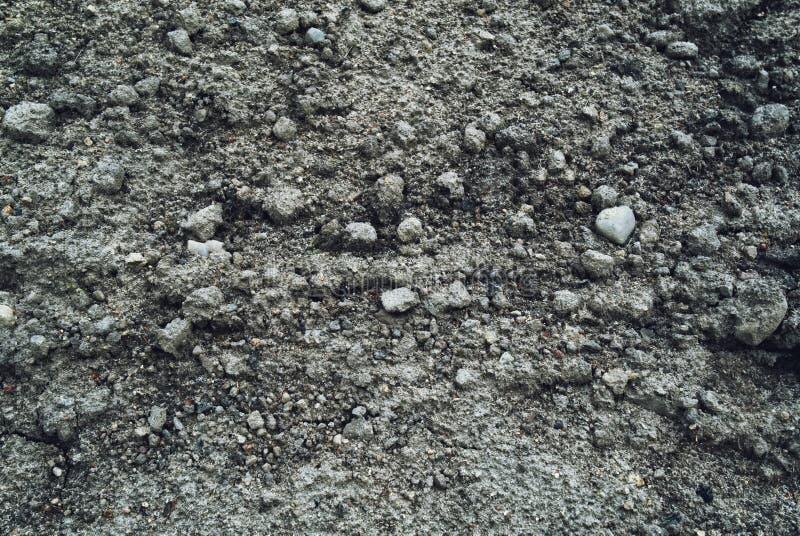 Graubeschaffenheit, -sand und -steine lizenzfreie stockbilder