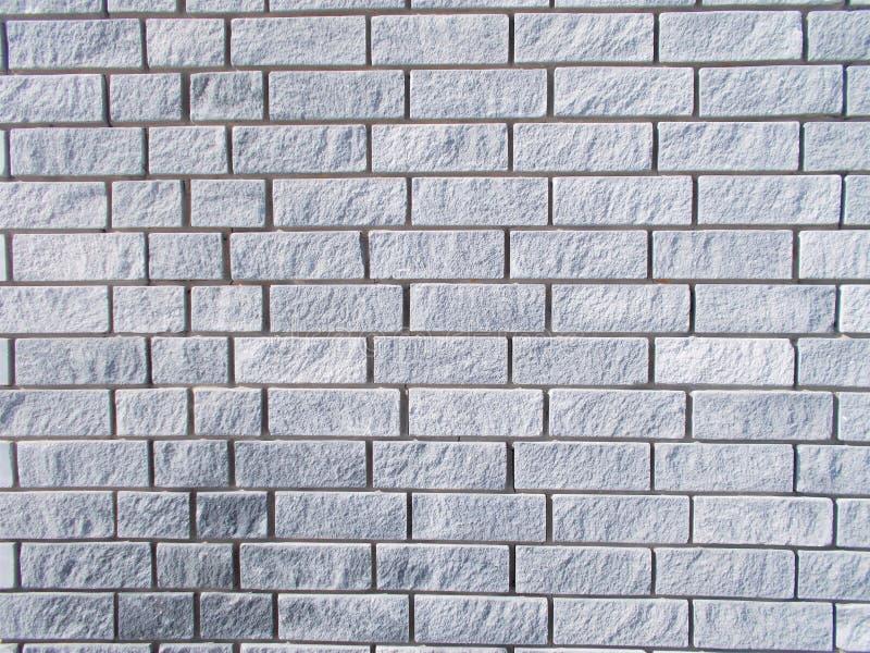Graue Backsteinmauerbeschaffenheit stockfotos