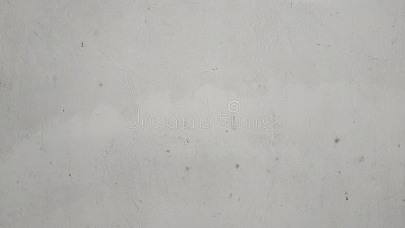 Graue Betonmauerbeschaffenheit des abstrakten Kratzerschmutzes mit der Schale der Farbe stockbild