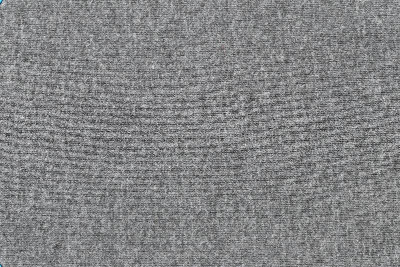 Graue Gewebebeschaffenheit des Oberflächentextilhintergrundes stockfotografie