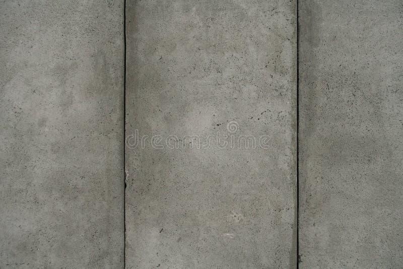 Graue Kleberwand stockbilder