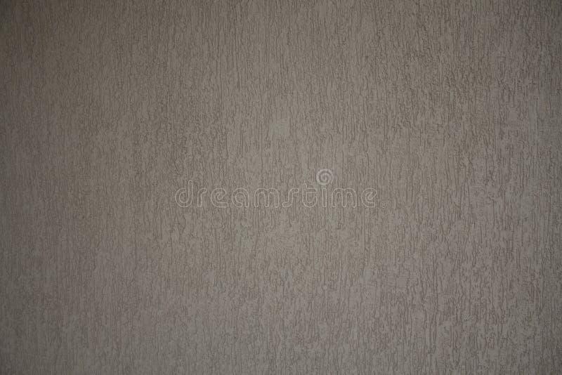 Graue konkrete Beschaffenheit der rauen und körnigen Wand stockbilder