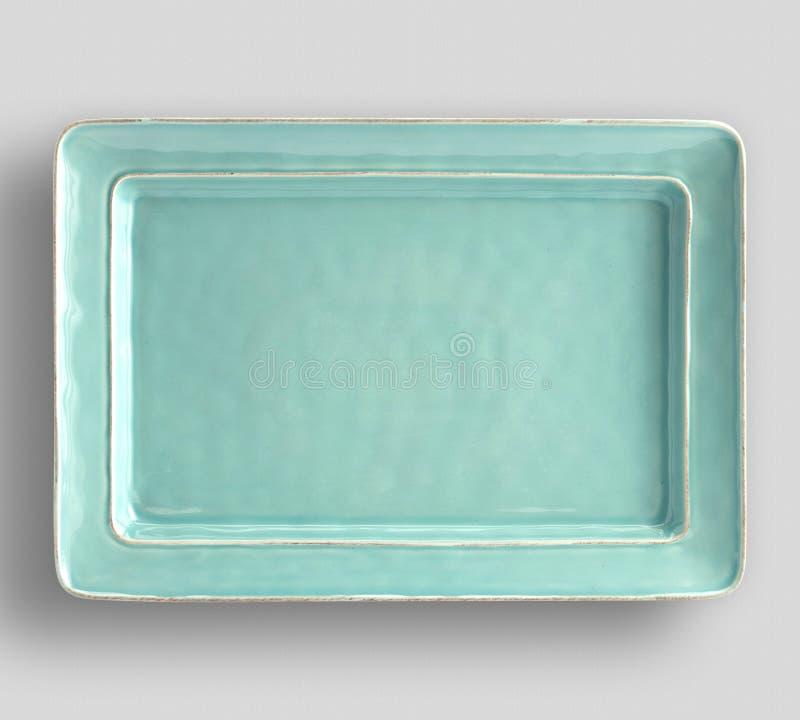 Graue Platte auf wei?em Hintergrund - Bild stockbilder