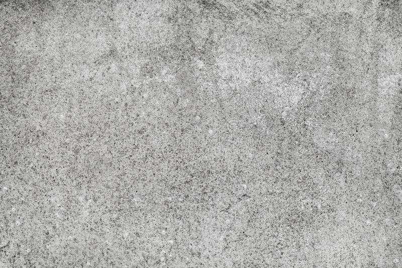 Graue raue Betonmauerhintergrundbeschaffenheit stockfoto