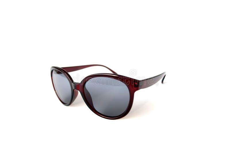 Graue Sonnenbrille auf weißem Hintergrund stockfotografie