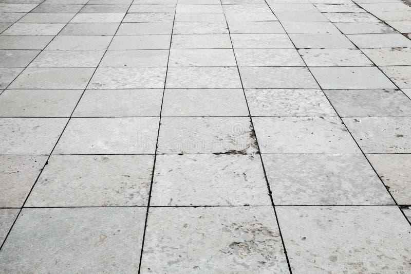 Graue Steinpflasterungsperspektive, quadratischer Boden Tiling stockbilder