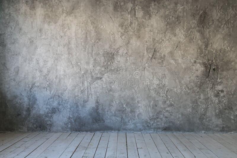Graue strukturierte Wand des Betons und des Holzfußbodens Freier Platz für Text stockfotos