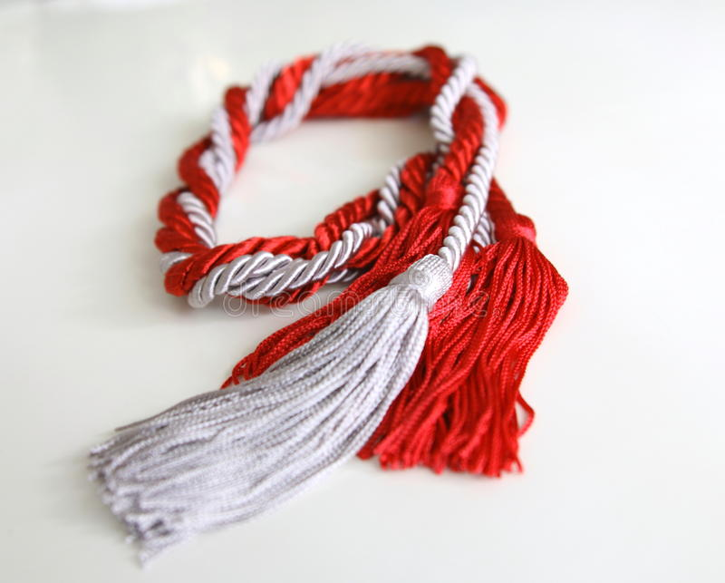 graue und rote Seile mit der Quaste lokalisiert lizenzfreies stockbild