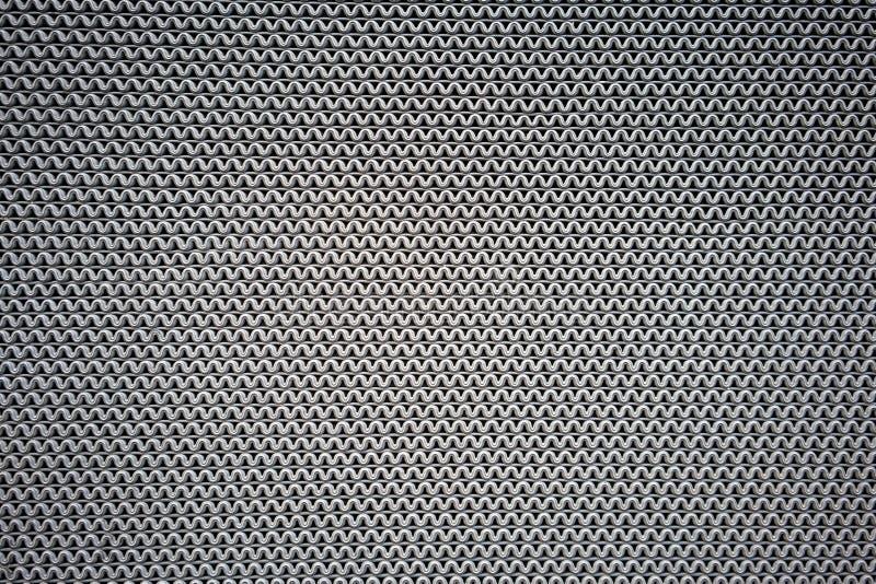 Graue Welle zeichnet das Muster, das vom Gummi für rutschfeste Matte für Text gemacht wird lizenzfreie stockfotografie