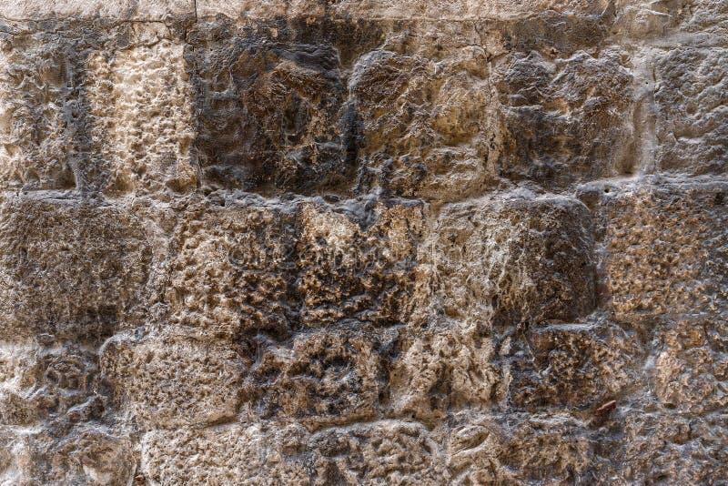 Graue Zementbacksteinmauer stockfoto