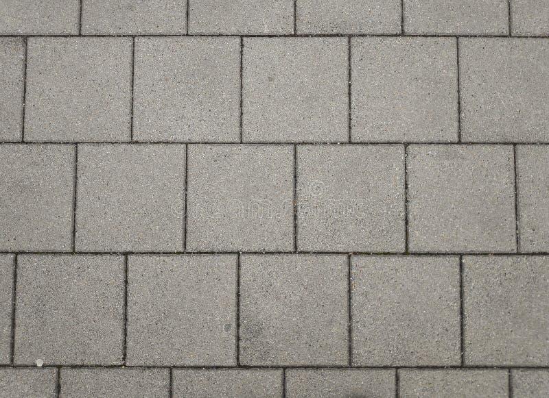 Grauer Betonziegelstrukturboden lizenzfreies stockfoto