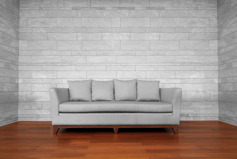Grauer Couchstuhl lizenzfreies stockfoto