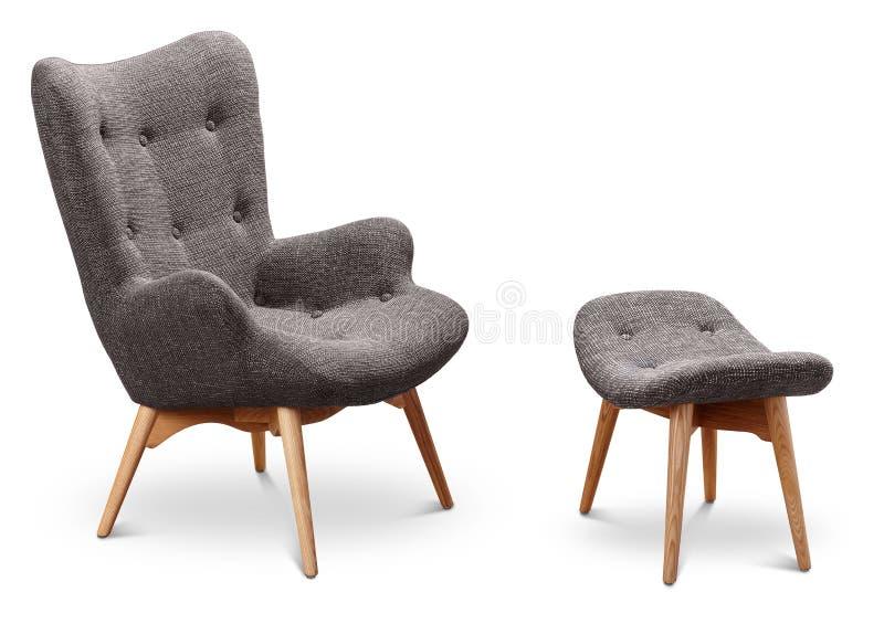 Grauer Farblehnsessel und kleiner Stuhl für Beine Moderner Designerlehnsessel auf weißem Hintergrund Textillehnsessel und -stuhl  lizenzfreies stockbild