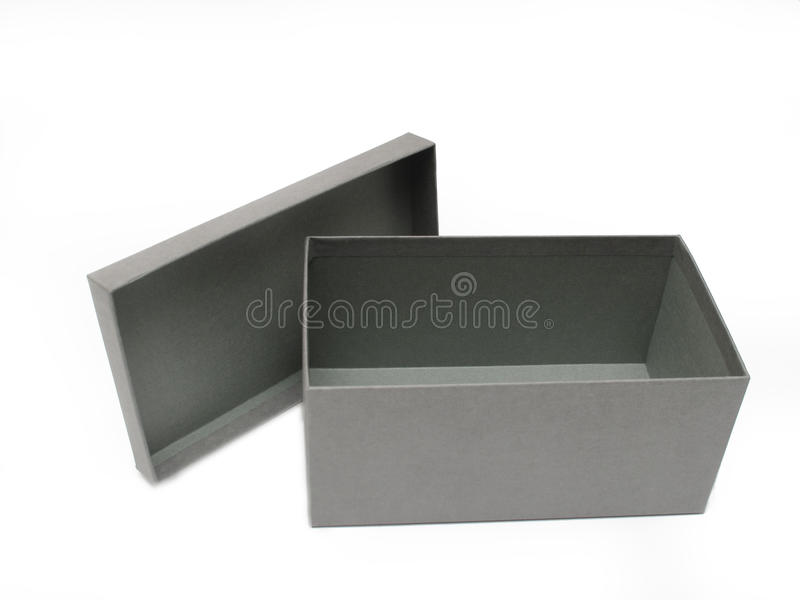 Grauer Geschenk-Kasten gegen einen weißen Hintergrund lizenzfreie stockfotos