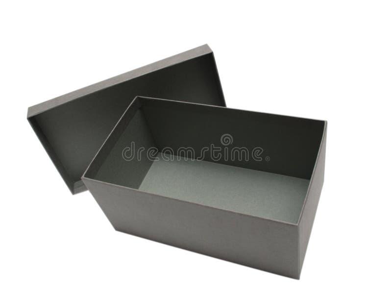 Grauer Geschenk-Kasten gegen einen weißen Hintergrund stockfotografie