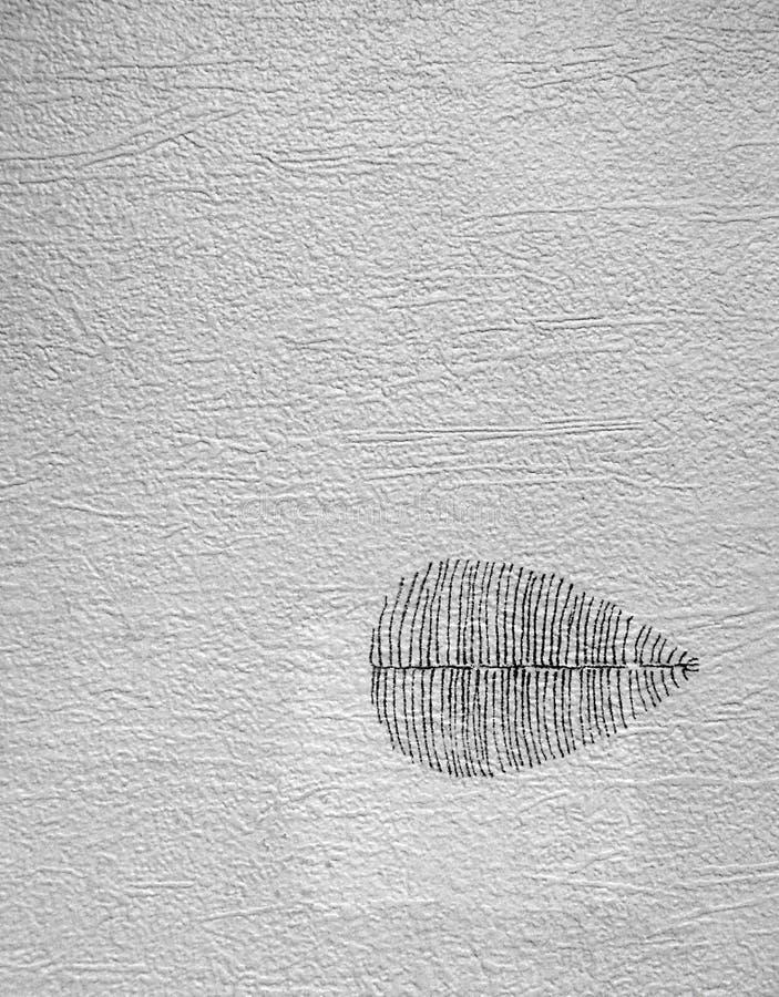 Grauer Hintergrund der Weinlese mit Blatt lizenzfreies stockbild
