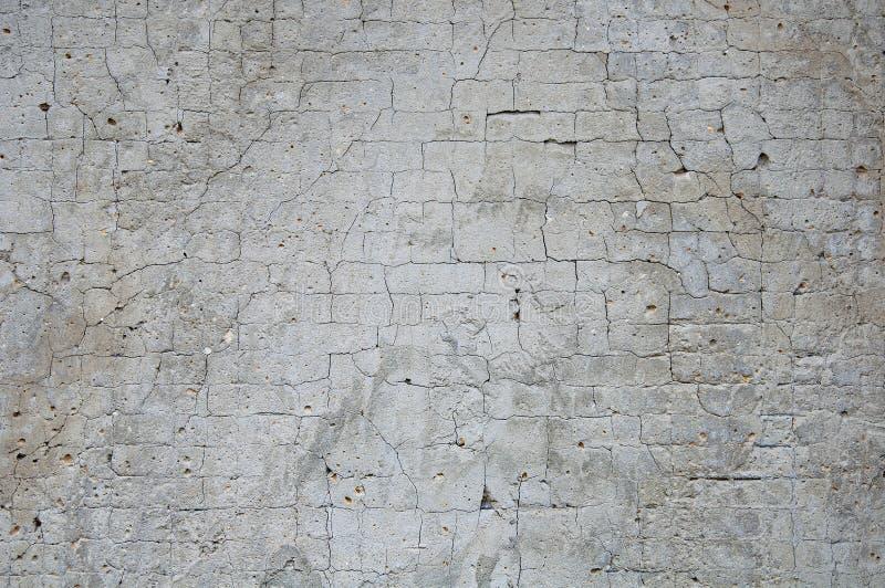 Grauer konkreter Beschaffenheitshintergrund besch?digung Gebrochener Steinwandhintergrund stockfotografie