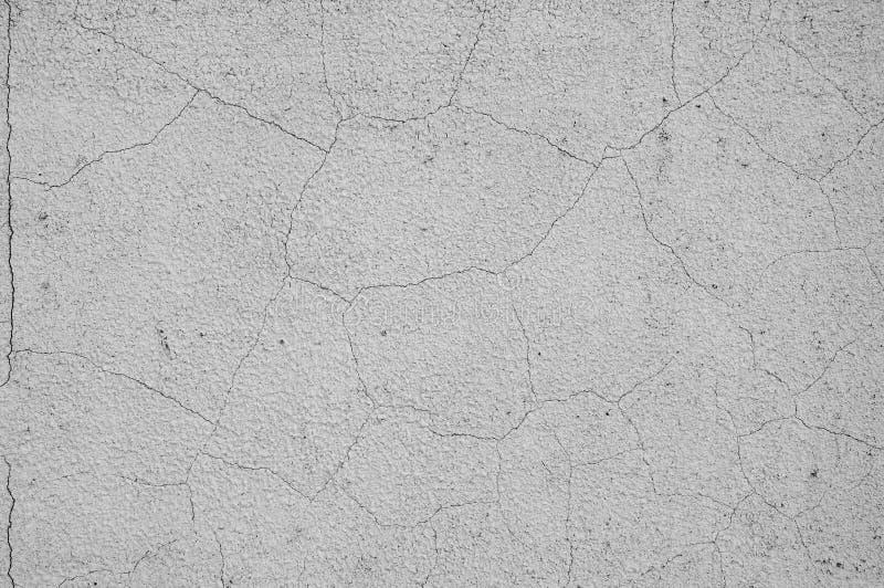Grauer konkreter Beschaffenheitshintergrund besch?digung Gebrochener Steinwandhintergrund stockfotos