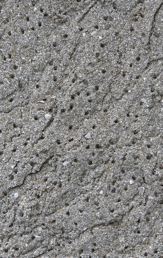 Grauer konkreter Beschaffenheitshintergrund besch?digung Gebrochener Steinwandhintergrund stockbild