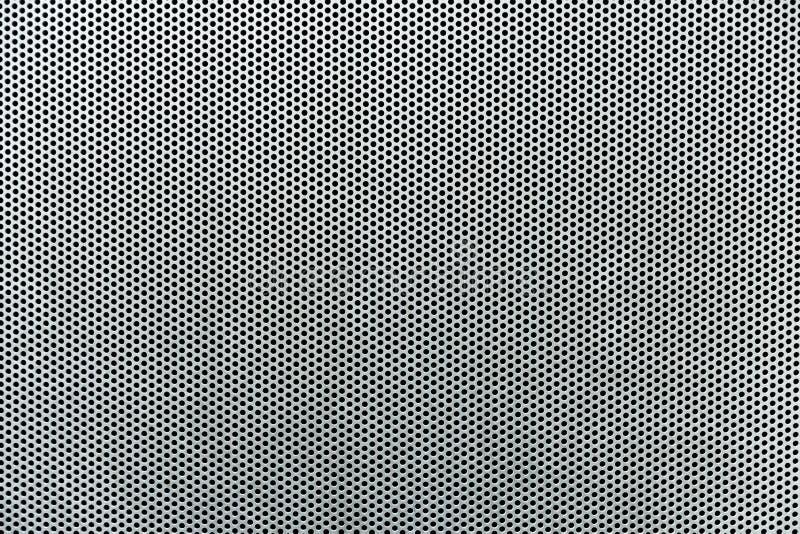Grauer Metallhintergrund, runde perforierte Metallbeschaffenheit stockbild