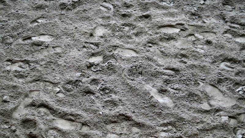 Grauer Sandbeschaffenheitshintergrund, Schritte stockbilder