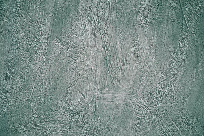 Grauer und grüner Schmutzhintergrund Gemalte Betonmauer Raue gewagte Beschaffenheitsoberfläche Abstraktes Muster für Dekorationse stockbilder