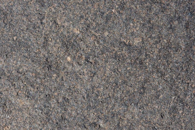 Grauer vulkanischer Sand, kleine Steinoberfläche Ausführlicher natürlicher Hintergrund oder Beschaffenheit lizenzfreie stockbilder